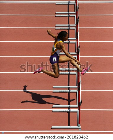 MONCTON, CANADA - June 28: Chanice Taylor-Chase competes in the women's 400-metre hurdles at the Canadian Track & Field Championships June 28, 2014 in Moncton, Canada. - stock photo