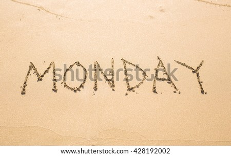 Monday - written in sand on beach texture, days week series