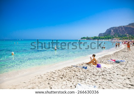 MONDELLO, ITALY - SEP 19, 2014: Unidentified people at the beach of Mondello on Sep 19, 2014 at Sicily. At the end of the 19th century Mondello grew into a favourite tourist destination. - stock photo