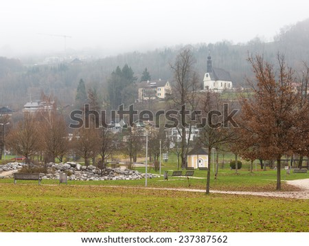 Mondsee - December 4, 2014 - the park for walking with a green lawn and the Alps in the distance in the vicinity of Lake Mondsee December 4, 2014, Mondsee, Austria - stock photo