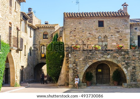 MONELLS, SPAIN - SEPTEMBER 26, 2015: Medieval streets in the Catalan village of Monells, Spain
