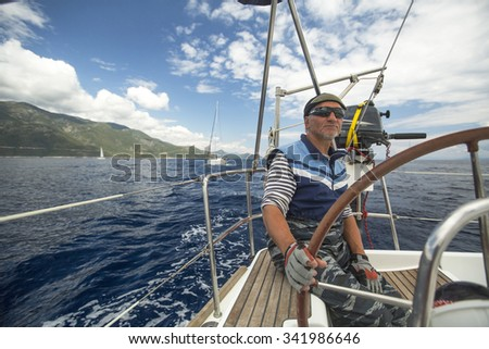 MONEMVASIA, GREECE - CIRCA MAY, 2014: Sailor participates in sailing regatta 11th Ellada 2014 Spring among Greek island group in the Aegean Sea, in Cyclades and Argo-Saronic Gulf.