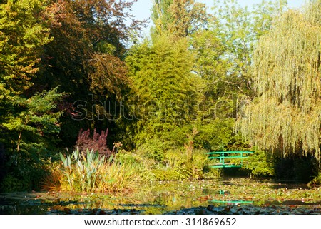 Monet's water lily pond made by Clode Monet himself - this scenery has been inspiration for a lot of his impressionistic artwork - stock photo