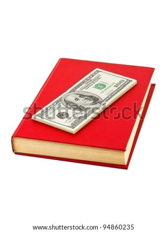 Money and book isolated on white background