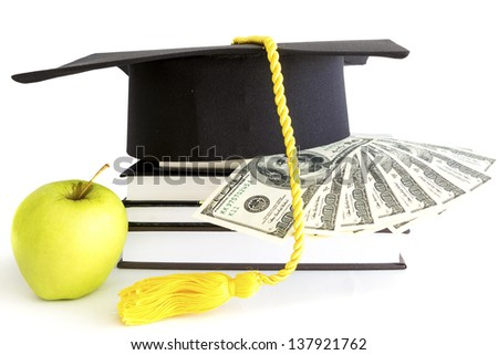 Money and books for education - stock photo
