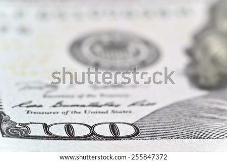 Money and business concept - dollars banknotes. Focus on number 100