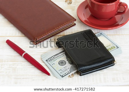 Money and coffee on the table