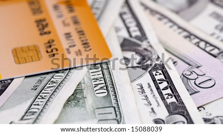 Money and credit card with minimum DOF - stock photo