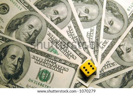 Money and die. - stock photo