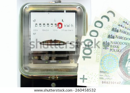 Money and electric energy meter old electromechanical type, power meter, concept for energy saving - stock photo