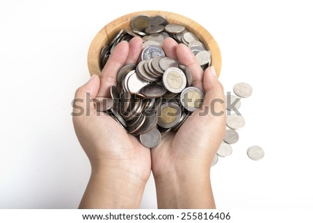 money and finances concept - close up of womans cupped hands showing  coins - stock photo