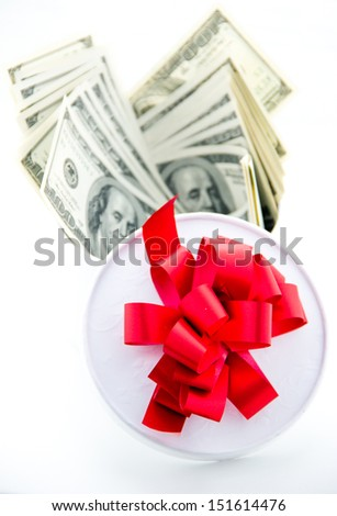 Money and gift box isolated on the white background.