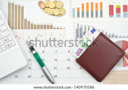 Money and graphs for finance concept   - stock photo