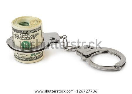 Money and handcuffs isolated on white background - stock photo