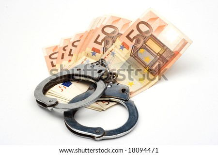 money and handcuffs over white - stock photo