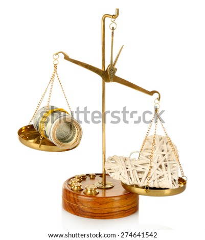 Money and heart in balance scales - stock photo
