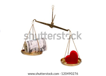 Money and heart on scales isolated on white background.