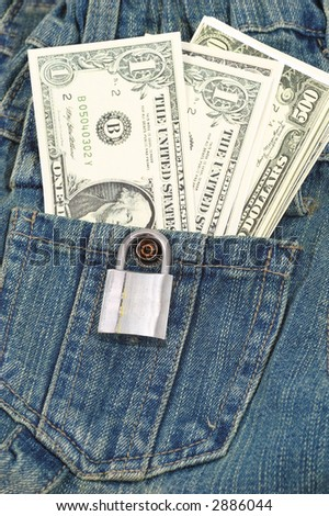 money and lock in a jean pocket - stock photo