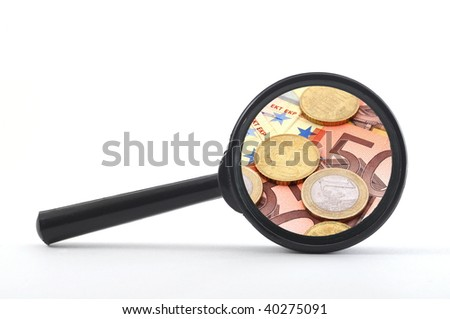 money and magnifying glass showing financial success - stock photo