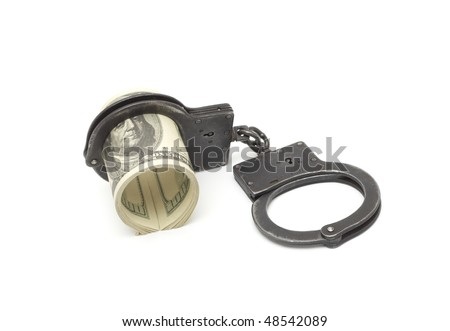 Money and manacles isolated on white background