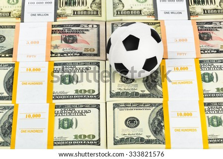 Money and soccer ball - sport and business background - stock photo