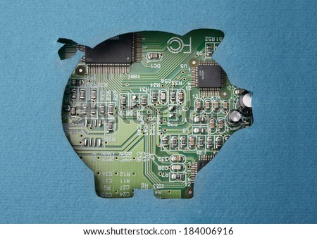 Money and technology. Cardboard piggy bank cutout revealing circuit board content - stock photo