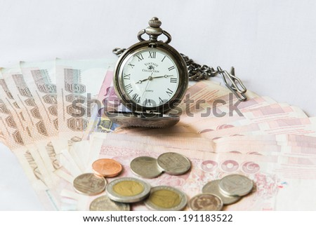 Money and vintage pocket watch ,Time and financial concept.