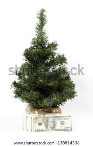 Money around the Christmas tree - stock photo