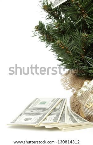 Money around the Christmas tree on white background - stock photo