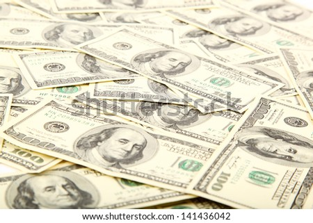 Money as a background. A stack of one hundred dollar bills.