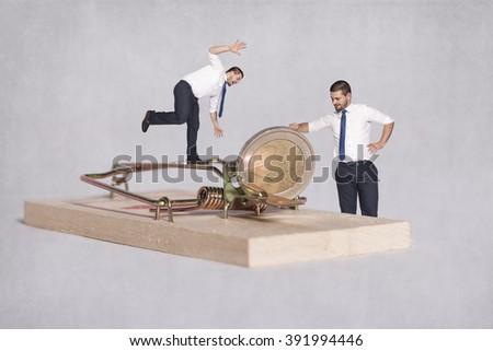 money as an ambush on greedy - stock photo