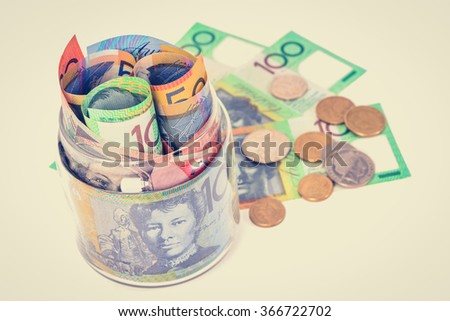 Money, Australian dollar banknotes and coins, vintage tone - stock photo