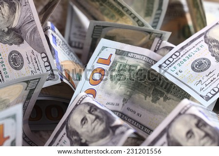 Money background of dollars in cash pile - stock photo