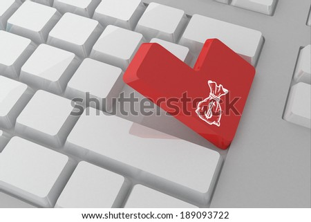 Money bag against white keyboard with red key