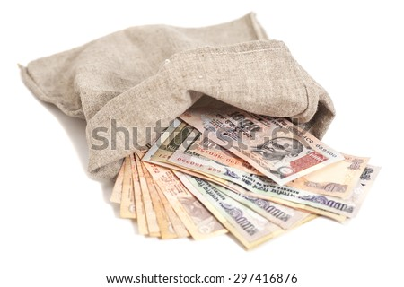 Money bag with Indian Currency Rupee bank notes on white background - stock photo