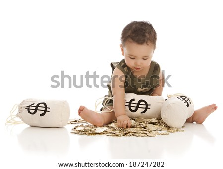 Money Bags.  An adorable baby boy sitting on a pile of gold coins with money bags.  Isolated on white with room for your text. - stock photo