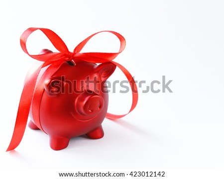 money box red piggy bank with gift ribbon - stock photo