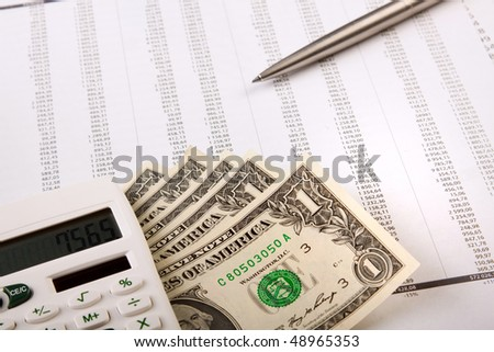 money, calculator and calculations - stock photo