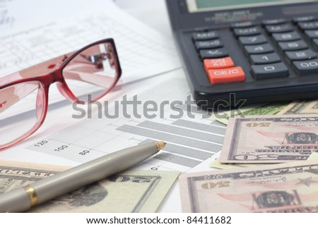 Money, calculator and pen