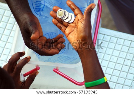 Money changing hands on the street of ghana - stock photo