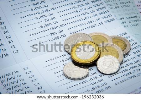 Money coins and bank statement - stock photo