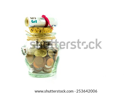 Money - coins and banknotes - in a jar on white background - stock photo