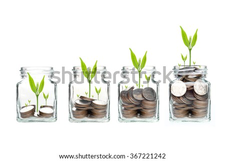 money coins in clear bottle on white background,Business investment growth concept,saving concept - stock photo