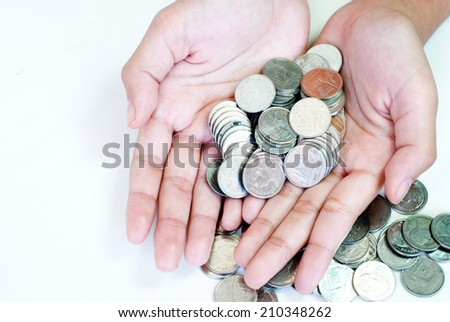 Money coins in hand. - stock photo
