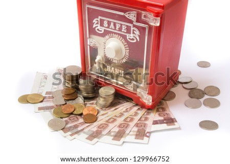 Money coins in safe bank isolated on white - stock photo