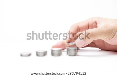 Money coins pile isolate on white background,hand putting on money coin saving and business growth concept - stock photo