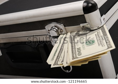 Money coming out of suitcase
