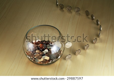 Money coming to the bowl - stock photo