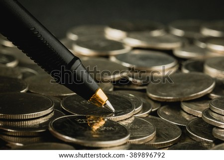 money concept coins and pen with filter effect retro vintage style - stock photo