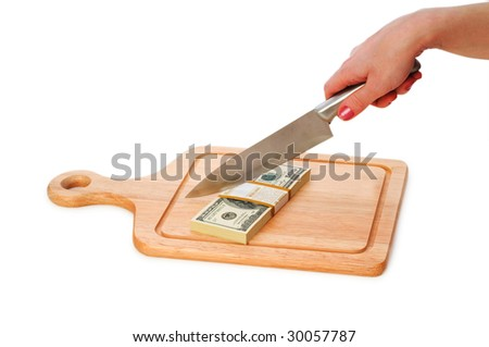 Money concept - cutting dollars with the knife - stock photo